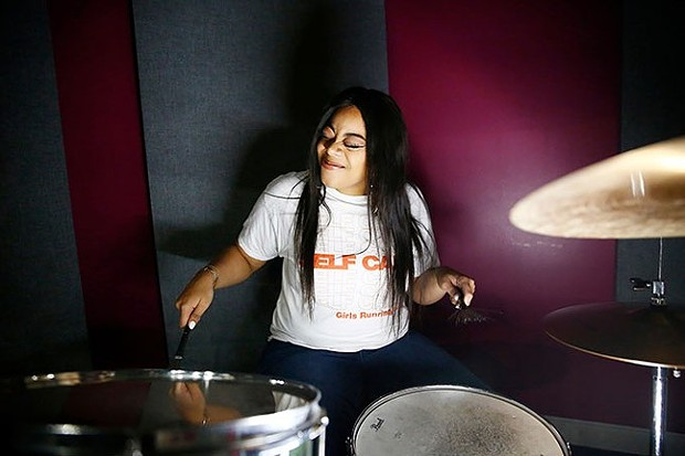 INEZ plays drums at the YMCA Lighthouse Project - CP PHOTO: JARED WICKERHAM
