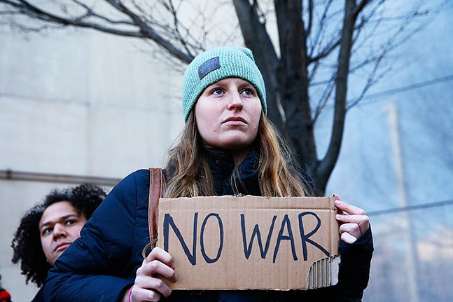 An anti-war protest put on by the Pittsburgh Anti-Imperialism Committee outside the Federal Building in Downtown Pittsburgh on Mon., Jan. 6 - CP PHOTO: JARED WICKERHAM