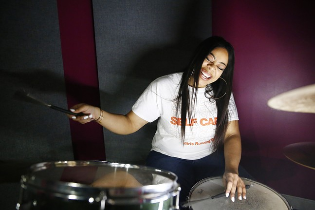 INEZ plays drums at the YMCA Lighthouse Project in Homewood. - CP PHOTO: JARED WICKERHAM