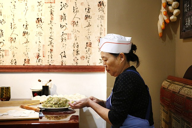 Guoqing Wu prepares pork and cabbage dumplings at Northeastern Kitchen in Squirrel Hill. - CP PHOTO: JARED WICKERHAM
