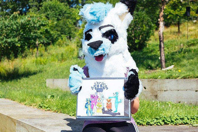 Pittsburgh furry Ava Wos as Akela shows off her artwork for Anthrocon 2019. - CP PHOTO: JARED MURPHY