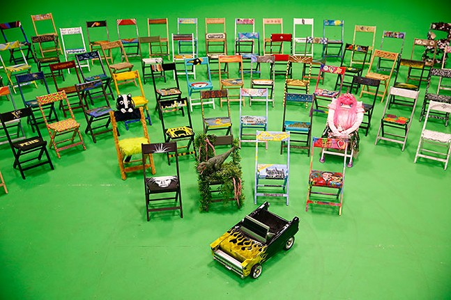 """Various parking chairs made by Pittsburgh artists, showcased as part of VisitPittsburgh's """"Pull Up a Chair"""" campaign - CP PHOTO: JARED WICKERHAM"""