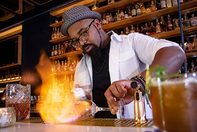 Akil Babb, head bartender at Bridges & Bourbon - CP PHOTO: MEGAN GLOECKLER