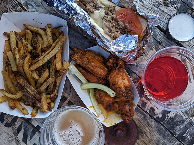 Fries, chicken wings, and shaved brisket sandwich from Streets on the Fly - CP PHOTO: MAGGIE WEAVER
