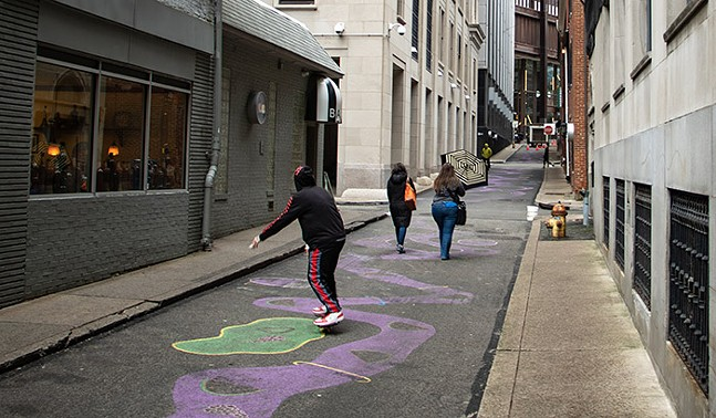 Pittsburgh artist Julie Mallis' street mural on Strawberry Way - CP PHOTO: MEGAN GLOECKLER