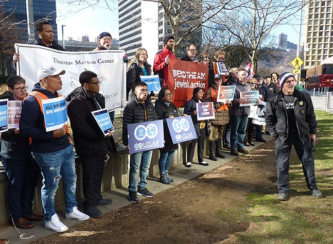 More than 30 advocates rally in Downtown Pittsburgh, just outside the Colcom Foundation offices - CP PHOTO: RYAN DETO