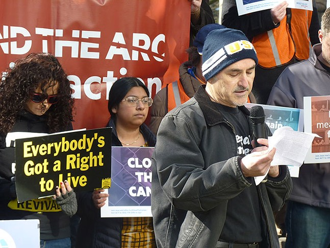 Guillermo Perez speaks at a rally condemning Colcom Foundation's donations to anti-immigrant groups - CP PHOTO: RYAN DETO