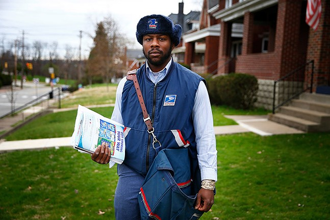 Colin Killins, United States Postal Service, on his route in Stanton Heights - CP PHOTO: JARED WICKERHAM