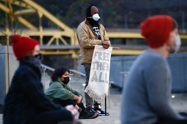 A vigil for inmates who have died at Allegheny County Jail was held at Point State Park on Sun., April 19. - CP PHOTO: JARED WICKERHAM