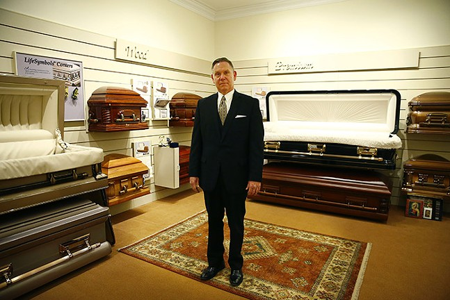 John Henson, director of Slater Funeral Service, poses for a portrait in the casket room in Green Tree on Fri., April 17, 2020. - CP PHOTO: JARED WICKERHAM