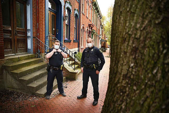 Pittsburgh Police officers Chris Vissichelli and Jason Pokorny pose for a portrait in Pittsburgh's Manchester neighborhood on Sat., April 18, 2020. - CP PHOTO: JARED WICKERHAM