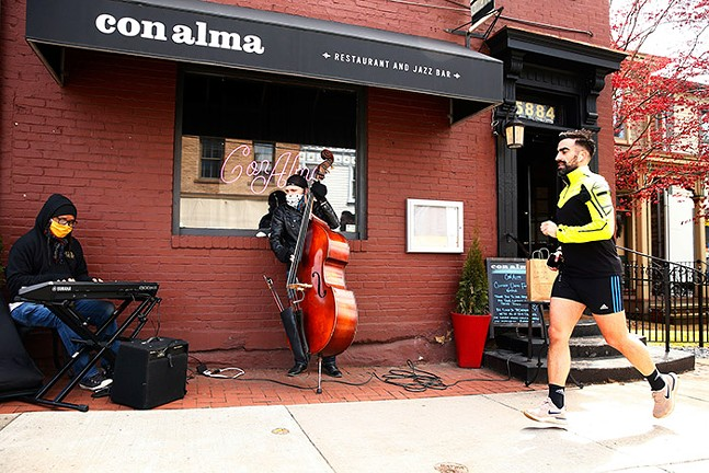 Howie Alexander and Tony DePaolis play in front of Con Alma in Shadyside. - CP PHOTO: JARED WICKERHAM