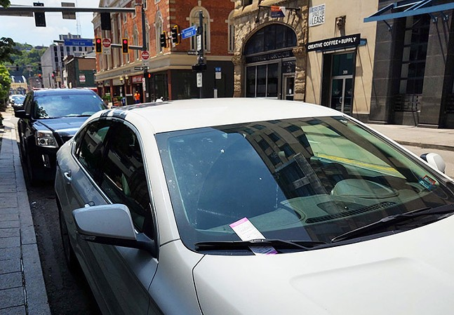 Cars parks on Smithfield Street in Downtown Pittsburgh on Mon., May 18, 2020. - CP PHOTO: KEVIN SHEPHERD