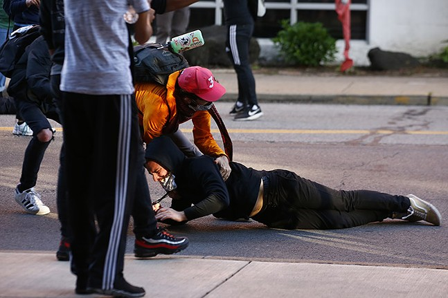 Man hit by a rubber bullet or bean bag on Centre Avenue - CP PHOTO: JARED WICKERHAM