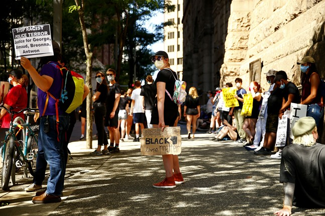 Protesters gather outside of the Allegheny County Courthouse in Downtown Pittsburgh along Grant Street. - CP PHOTO: JARED WICKERHAM