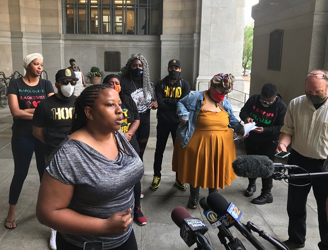 Brandi Fisher of the Alliance of Police Accountability speaks at a press conference - CP PHOTO: RYAN DETO