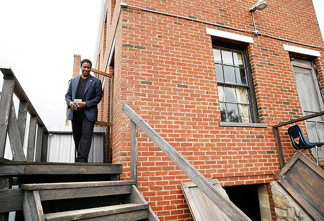 Denzel Washington, who starred in Pittsburgh playwright August Wilson's Fences Broadway play in 2010 and movie adaptation in 2016, took part in a community groundblessing at the August Wilson House in the Hill District on Wed., Sept. 26, 2018. - CP PHOTO: JARED WICKERHAM