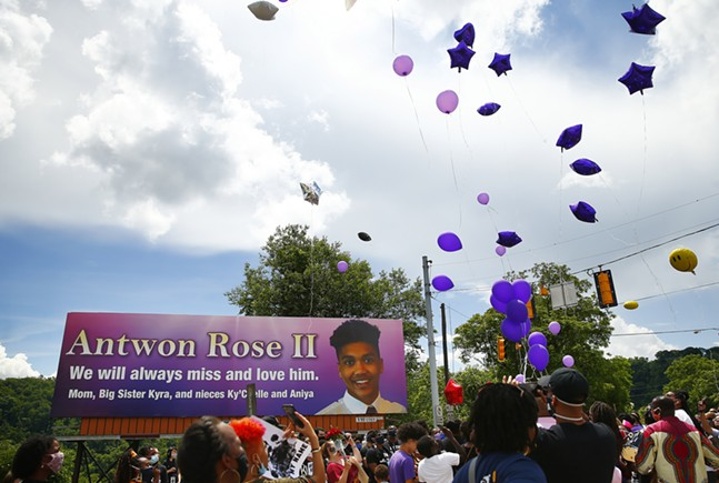 Balloons are released by family members of Antwon Rose II in memory of him in front of the billboard along Route 30 in East Pittsburgh. - CP PHOTO: JARED WICKERHAM