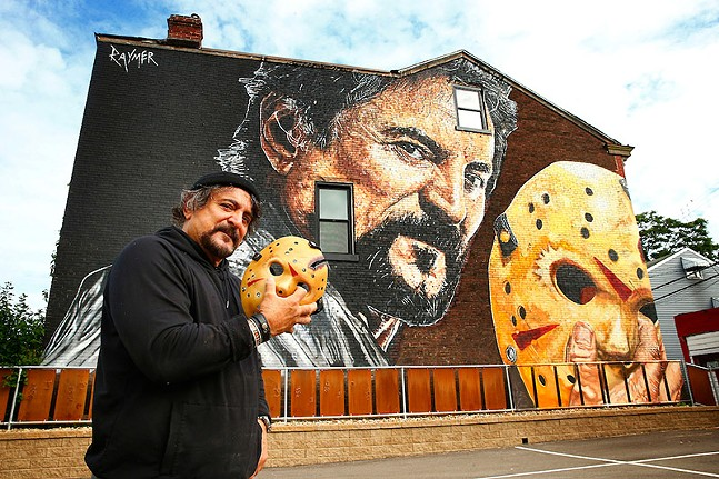 Tom Savini poses in front of the mural Pittsburgh artist Jeremy Raymer painted of his likeness in honor of his work on Friday the 13th movies - CP PHOTO: JARED WICKERHAM