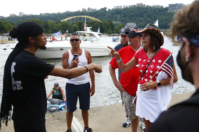 Pittsburgh activist Lorenzo Rulli speaks to a group of pro-Trump supporters on the North Shore. - CP PHOTO: JARED WICKERHAM
