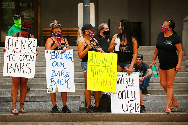 Bar owners and bartenders rallied in front of the City-County Building in Downtown Pittsburgh in disapproval of the governor's orders to shut down all bars amidst rising positive cases of coronavirus on Thu., July 2, 2020. - CP PHOTO: JARED WICKERHAM