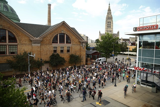Protesters march down Centre Avenue shouting 'Black people used to live here!' through the East Liberty neighborhood. - CP PHOTO: JARED WICKERHAM