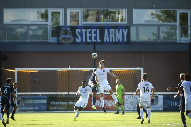 An empty balcony and standing-room only section sit empty as Mark Forrest #16 of the Pittsburgh Riverhounds goes up for a header against Indy Eleven. - CP PHOTO: JARED WICKERHAM