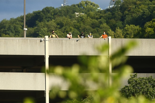 A group of Pittsburgh Riverhounds supporters watch the match from a nearby parking garage. - CP PHOTO: JARED WICKERHAM