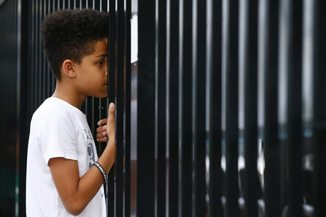 Pittsburgh Riverhounds supporter, Savi D., looks on through the fence. - CP PHOTO: JARED WICKERHAM