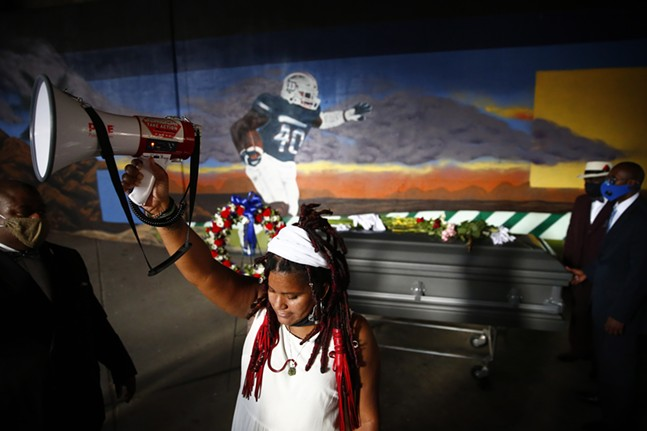 A mural in honor of Marquis Jaylen Brown is revealed to the surprise of Dannielle Brown. - CP PHOTO: JARED WICKERHAM