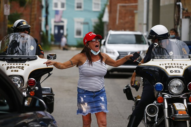 A Trump supporter yells at protesters near Mario's in Shadyside. - CP PHOTO: JARED WICKERHAM
