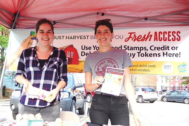 Just Harvest Fresh Access representatives helping bring Pittsburghers access to farm-fresh goods at area farmers markets. - PHOTO: COURTESY OF JUST HARVEST