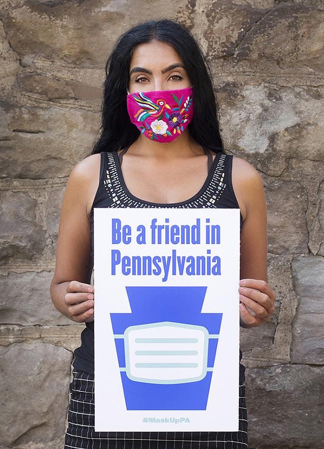 Gisele Fetterman holding a #MaskUpPA poster - PHOTO: LARRY RIPPEL
