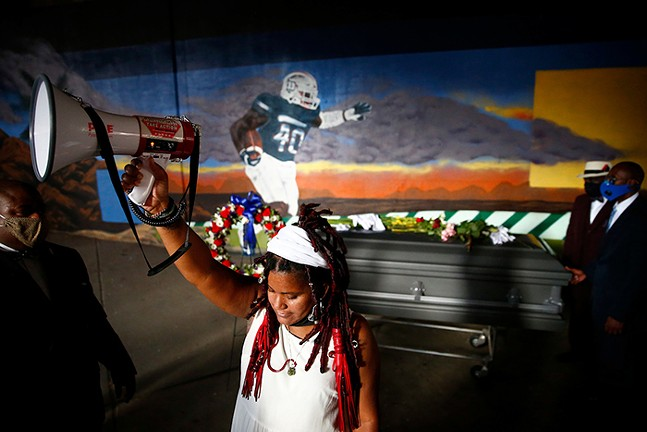 Dannielle Brown in front of a mural in honor of her son, Marquis Jaylen Brown - CP PHOTO: JARED WICKERHAM