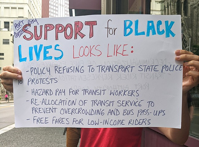 A protester holds up a sign of support. - CP PHOTO: LISA CUNNINGHAM
