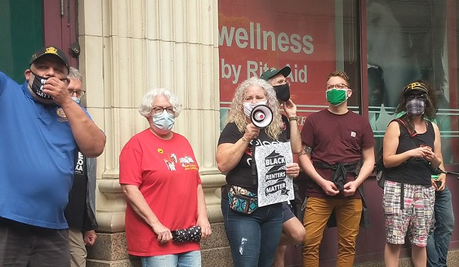 Protesters show support for bus operators wearing Black Lives Matter masks in Downtown Pittsburgh on Wed., Sept. 2, 2020. - CP PHOTO: LISA CUNNINGHAM