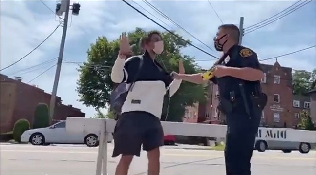 Screenshot of the arrest at the Squirrel Hill farmers' market on Sun., Sept. 6 - SCREENSHOT TAKEN FROM VIDEO SHARED WITH PITTSBURGH CITY PAPER