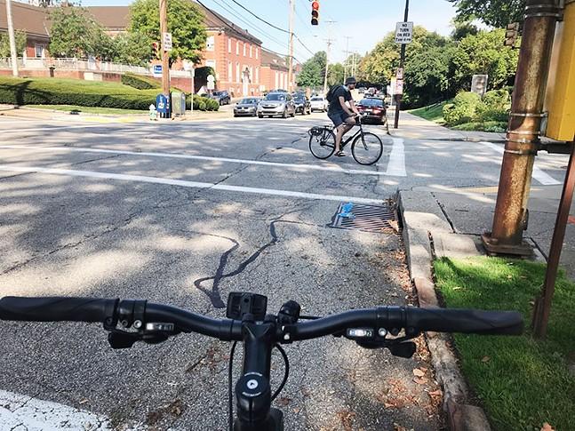 A cyclist rides on Ellsworth Avenue in Shadyside - CP PHOTO: RYAN DETO