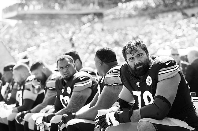 Alejandro Villanueva of the Pittsburgh Steelers sits on the bench during a game against the Seattle Seahawks on Sun., Sept. 15, 2019 in Pittsburgh. - CP PHOTO: JARED WICKERHAM