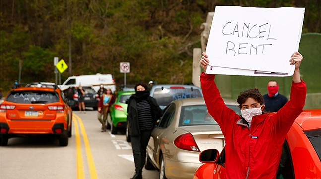Protest demanding a rent and mortgage freeze amid the COVID-19 pandemic on the Greenfield Bridge in Pittsburgh on May 1, 2020 - CP PHOTO: JARED WICKERHAM