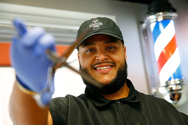 Joe Patterson, owner of JP's Barbershop - CP PHOTO: JARED WICKERHAM