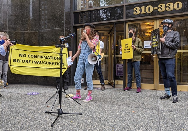EliseSilvestri of Sunrise Pittsburgh uses a megaphone during a protest outside of the Grant Building in Downtown Pittsburgh - CP PHOTO: AMANDA WALTZ