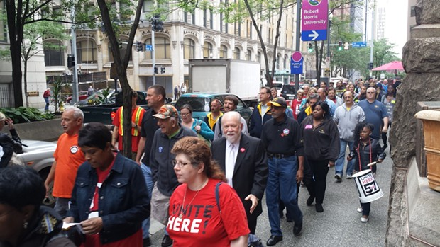 Workers and supporters march in front of the Allegheny County Courthouse. - PHOTO BY REBECCA NUTTALL