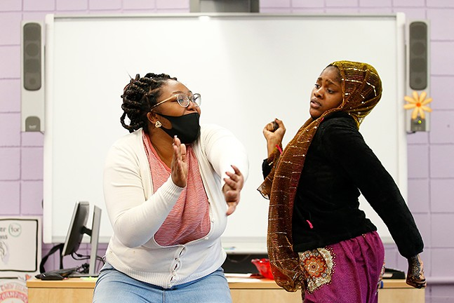 Shocoya Bates, volunteer with Gwen's Girls and doctoral student at Point Park University, dances with Madina Mada - CP PHOTO: JARED WICKERHAM
