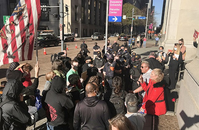 Protesters and counter-protesters clash in Downtown Pittsburgh. - CP PHOTO: RYAN DETO
