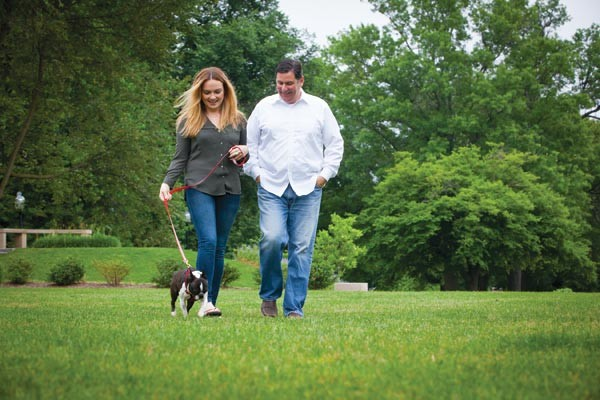 Mayor Bill Peduto and his girlfriend, Caitlin Lasky with Lilly, their recently adopted Boston terrier - PHOTO BY HEATHER MULL