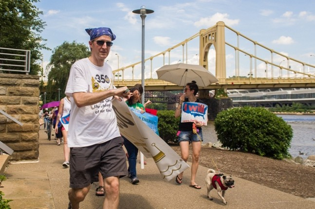 Pittsburgh 350, a climate activist group, marched along the Allegheny River this weekend. - PHOTO BY AARON WARNICK