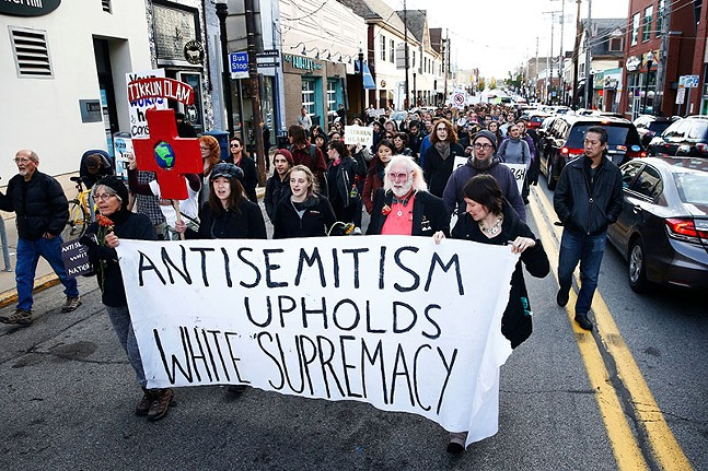 Pittsburghers marching in protest in October 2018 through Squirrel Hill towards the Tree of Life synagogue, where President Trump was making an appearance, three days after a mass shooting took place. - CP PHOTO: JARED WICKERHAM