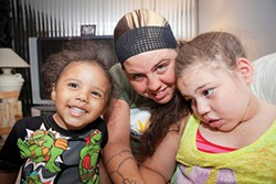 Jessica Hawkins, her daughter, Antania and son, Lucciano - PHOTO BY HEATHER MULL