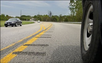 Example of the potential future centerline rumble strip proposed for Butler Street in Lawrenceville - WWW.TRANSPORTATION.GOV